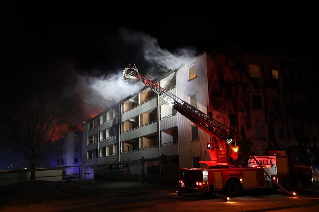 100 apartments evacuated after fire in western Sweden