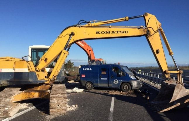 Armed gang use diggers to 'rip open' security van