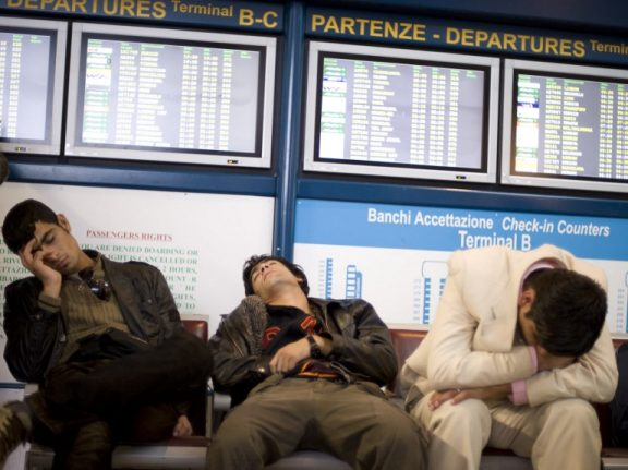 Scores of flights cancelled as Italian airline workers strike