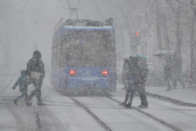IN PICTURES: High winds, torrential rain and snow hit Germany