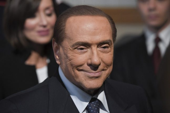 Italy's Berlusconi leaves hospital after op and vows to fight election