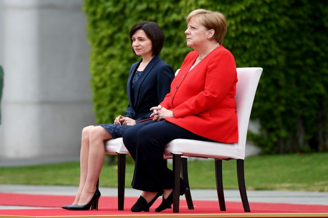 Merkel stays seated for second time after shaking spells