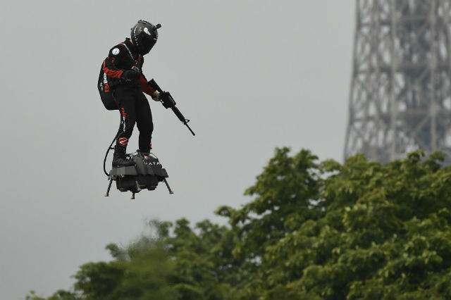 French inventor soars on flyboard above Bastille Day parade