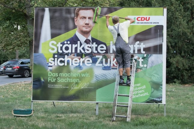 Race heats up in eastern German states as parties bid for votes in final election rallies