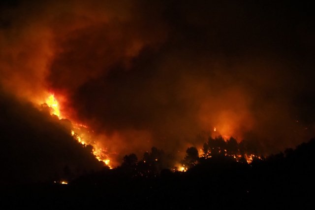 UPDATED: Strong winds fan wildfire raging in southern France