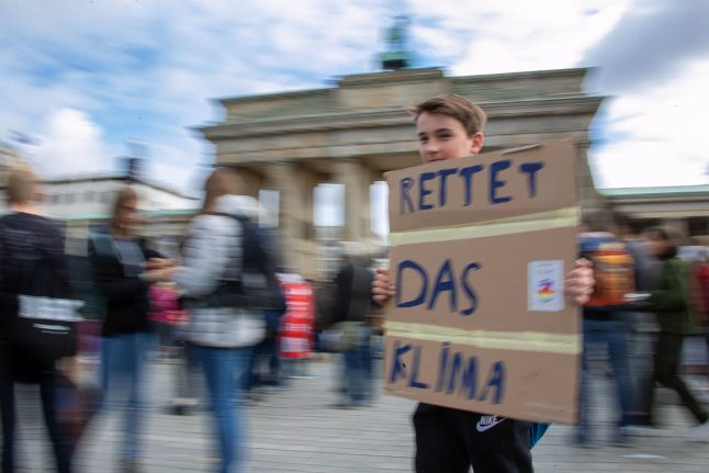 UPDATE: Germany reaches climate deal as protesters strike for change