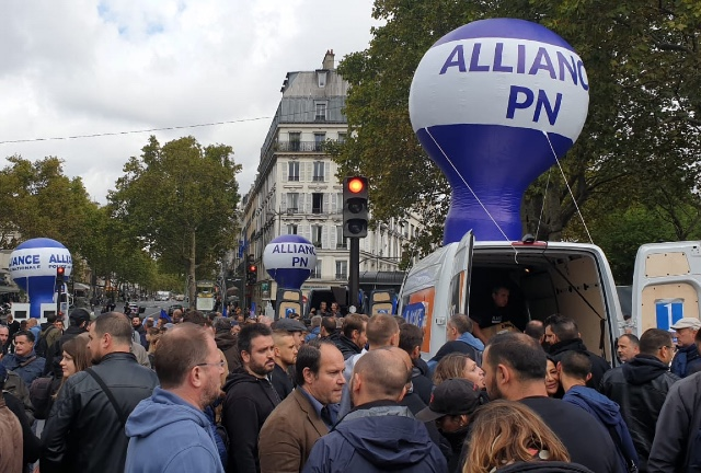 Why are French police holding an historic 'angry march' in Paris?