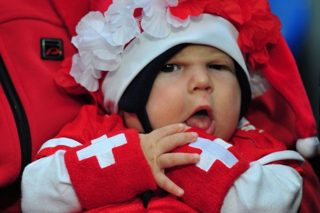 Switzerland to introduce two-week paternity leave after referendum attempt withdrawn