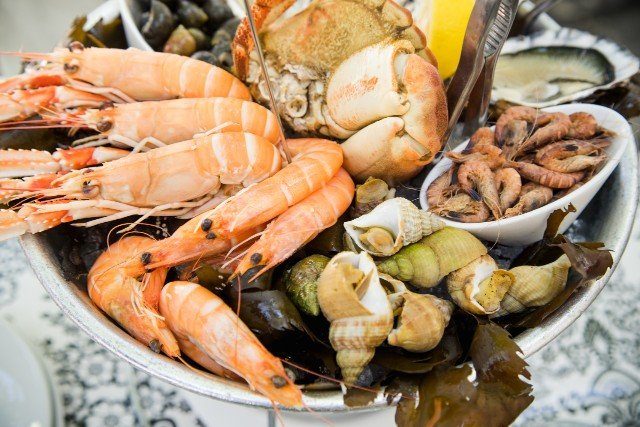 Why do the French eat so much seafood at Christmas?
