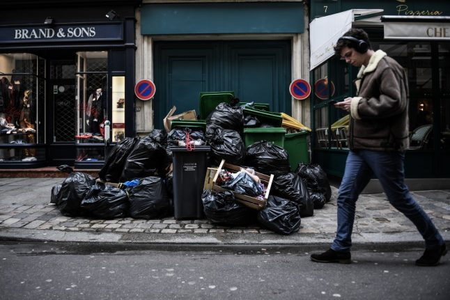 Rubbish piles up on Paris streets as pension strikes hit waste collection
