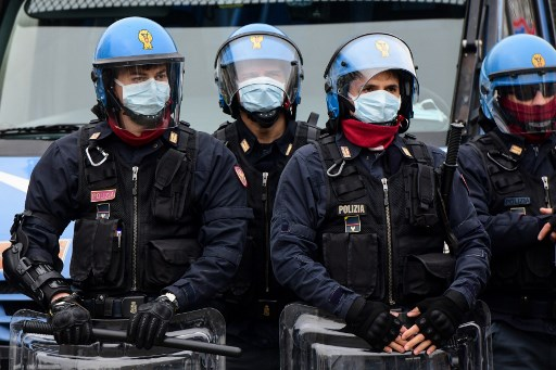Police hunt escaped prisoners in southern Italy after quarantine sparks riots