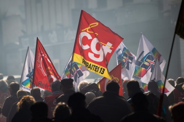 French unions protest government's decision to push through pension reform