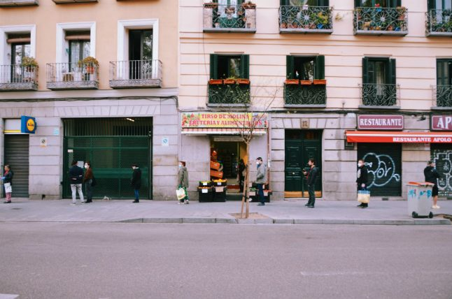 IN PICS: Madrid's hauntingly quiet streets and dystopian queues of shoppers