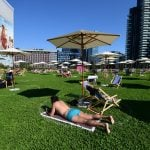 'It's not the seaside, but nearly': Milan residents test out new urban 'beach'