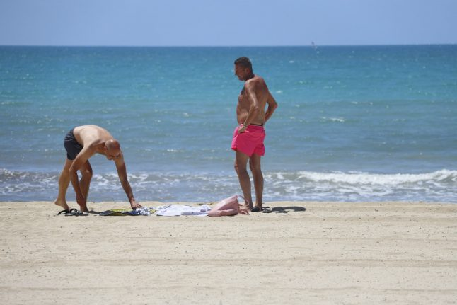 'We are very glad to be here': German tourists fly to Mallorca in post-Covid pilot project
