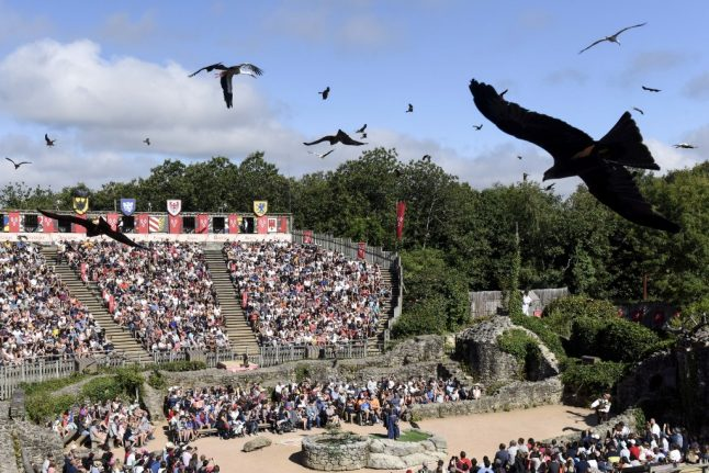 French government defends allowing theme park's 9,000-person show