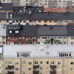 What extra fees should I expect when buying an apartment in Sweden?