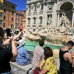 Italian police fine tourists €450 for carving names into Trevi Fountain
