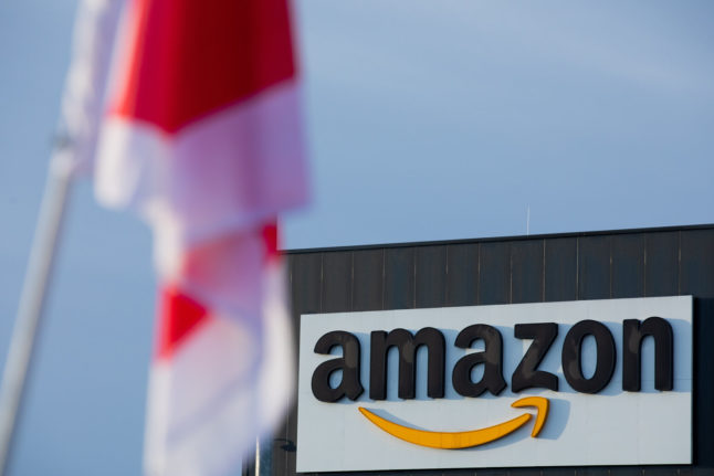 Amazon workers across Germany go on strike for higher wages in build up to 'online Xmas'