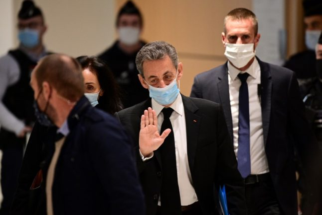 Ex French president Sarkozy takes the stand in his corruption trial