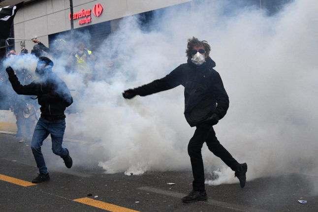 Close to 100 arrests made at violent French demos against new security bill