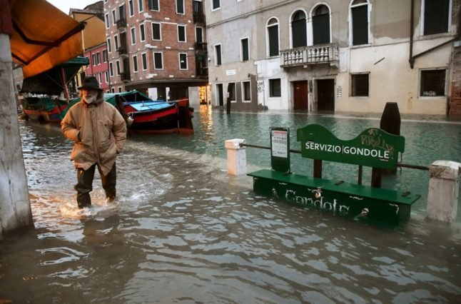 Venice tide barriers raised after flooding due to 'miscalculation'