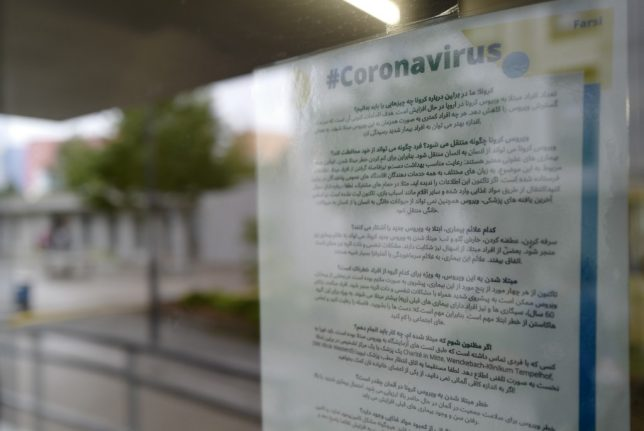 What has Germany done to inform and protect asylum seekers in the Covid-19 pandemic?