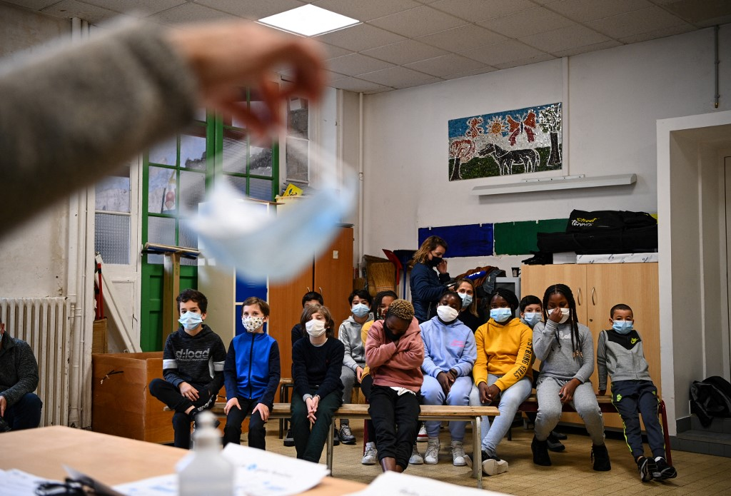 France bans the use of fabric face masks in schools over concerns about efficiency