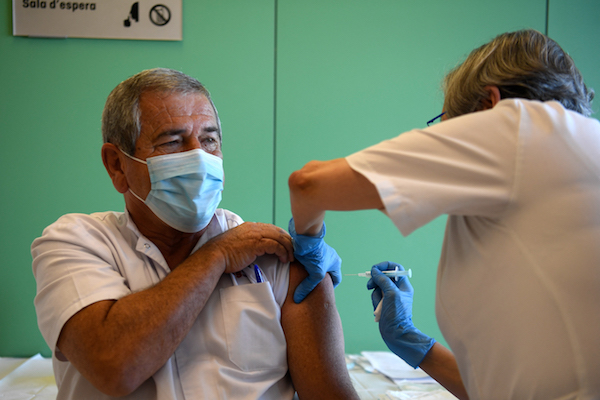 Man getting vaccinated in Catalonia