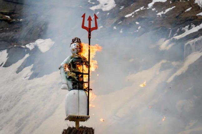 IN PICTURES: Swiss snowman blown up in mountains to herald 'great summer' ahead