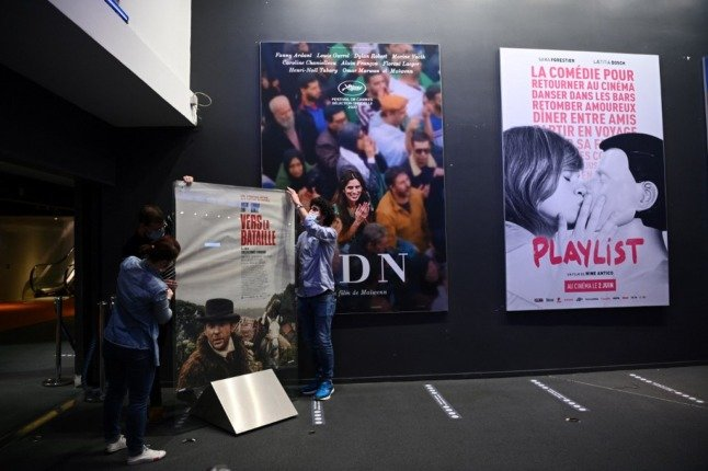 French flock back to cinemas as doors reopen after lockdown