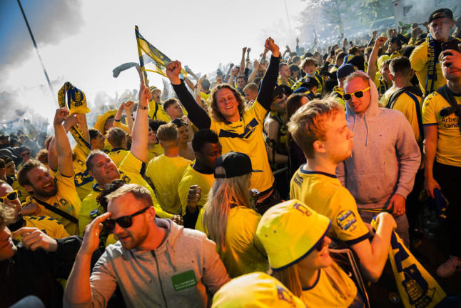 Danish football fans crowd together after rare championship win