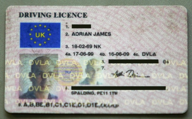 UK driving licence photocard. (Photo by ADRIAN DENNIS / AFP)