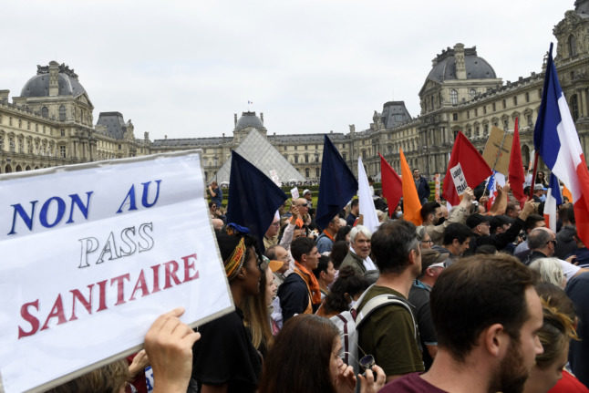 French vaccination centres vandalised as thousands protest health restrictions