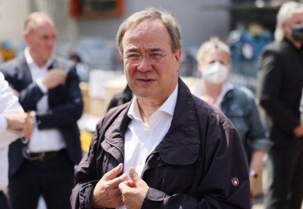 German chancellor candidate Laschet sparks anger with flood zone laughter