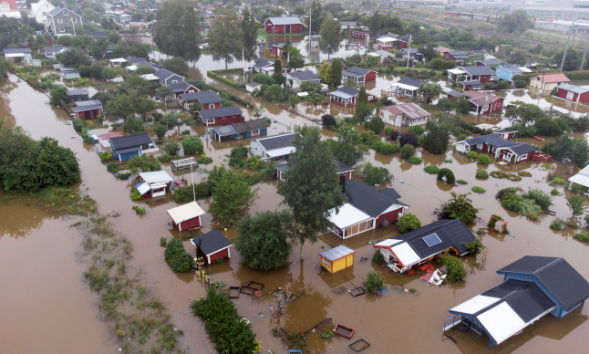 'Don't come here': Swedish city of Gävle flooded after DOUBLE a month's worth of rain falls overnight