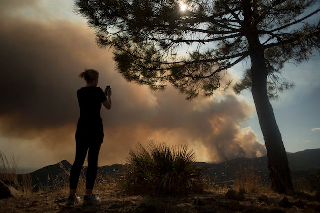 Rain helps fight against 'monster' wildfire in Spain