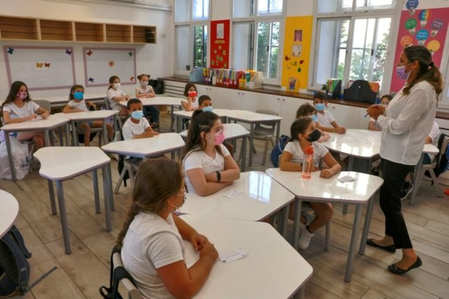 Italy considers dropping school mask mandate for fully-vaccinated classes