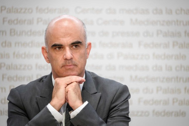 Swiss Health Minister Alain Berset against a grey background at a Covid press conference