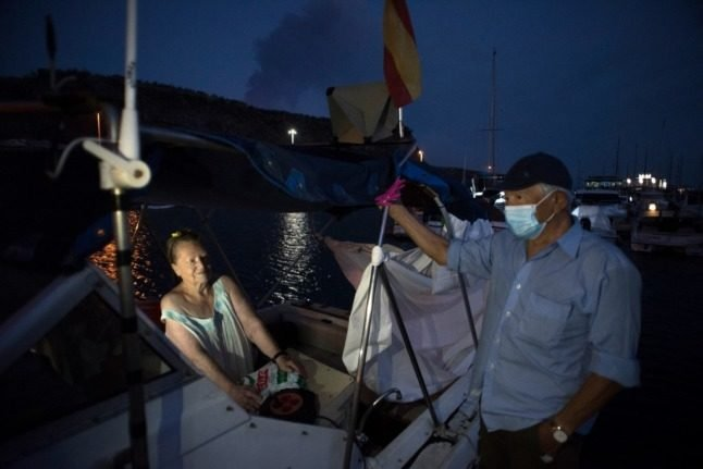 On a tiny boat, elderly couple find safe haven from La Palma's volcano