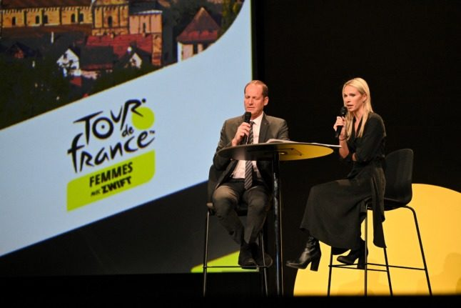 French cyclist Marion Rousse delivers a speech next to Tour de France director Christian Prudhomme during the presentation of the first edition of the Women's Tour de France cycling race.